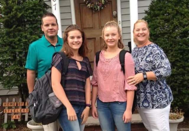 The Carroll Family is going back to school.