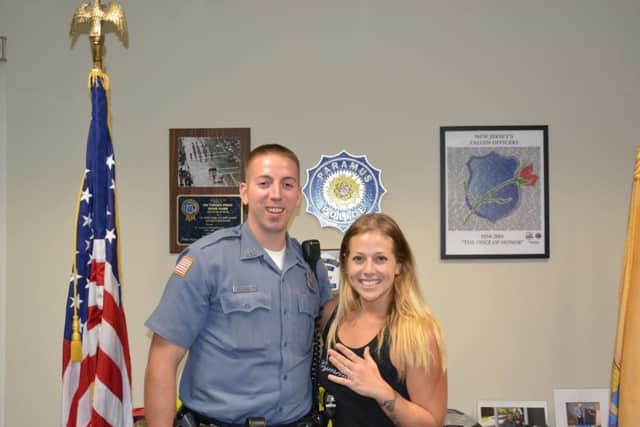 Paramus Police Officer Jon Henderson with Kimberly Garcia.