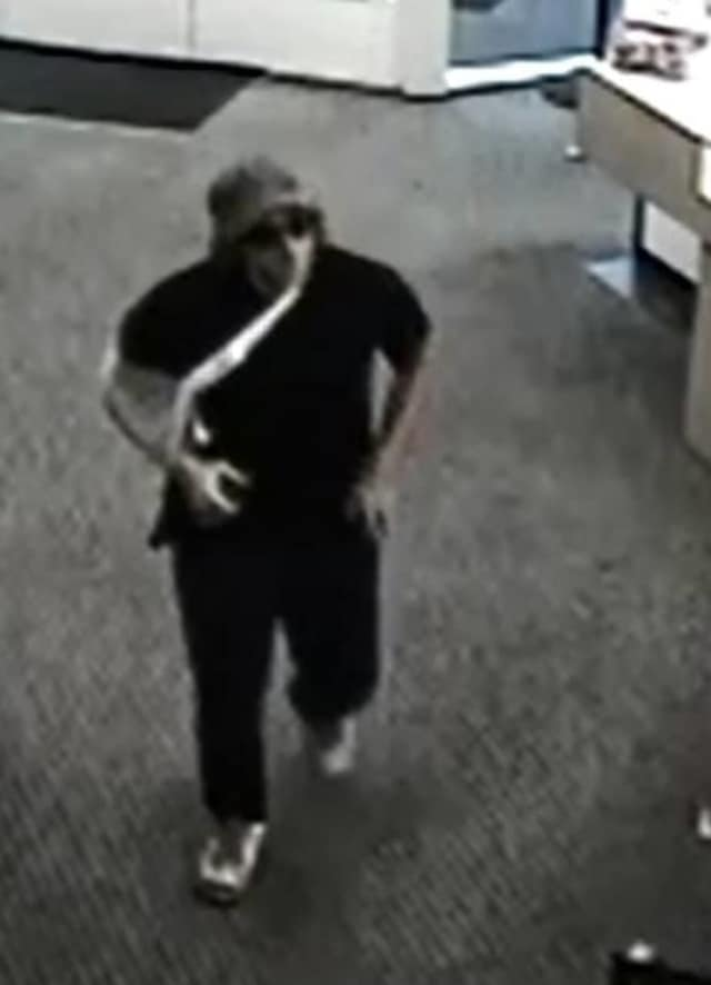 Monroe police released this surveillance photo of the suspect in the Thursday armed robbery of a People's Bank branch.