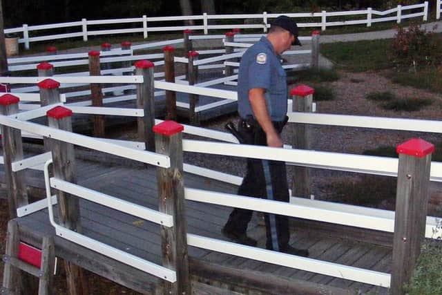 A Ridgewood police officer investigates graffiti at a local playground.