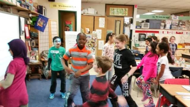 Third-graders at Woodglen Elementary School in New City are doing the Shake, Bake, Twist and Mist activity during a break at school.