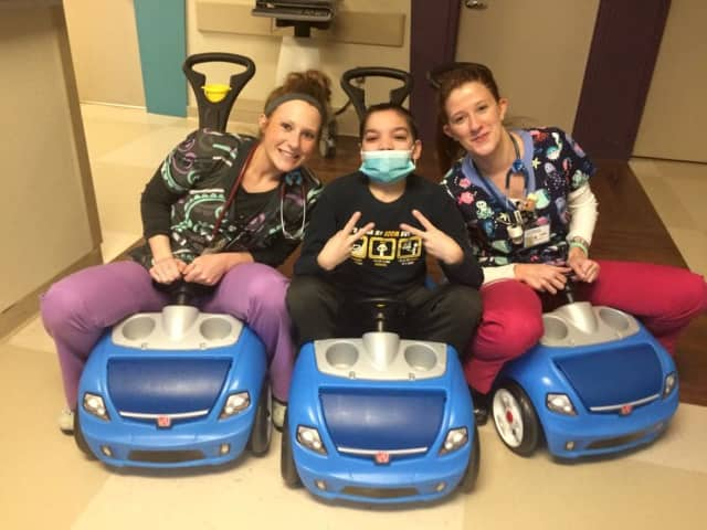 Jonathan Mechan of Maywood riding with with nurses at the hospital.