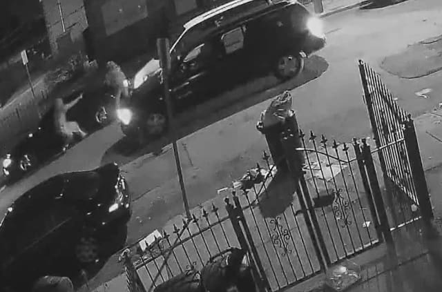 Screen capture from home surveillance video of Carl Dorsey III being shot by an undercover Newark police detective.