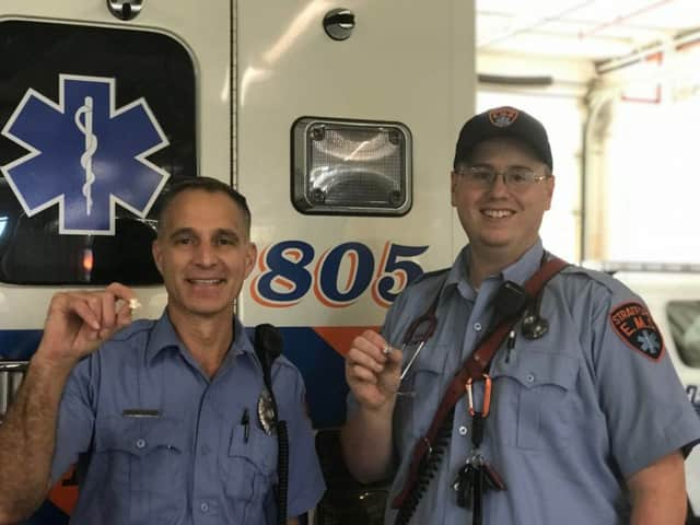 Stratford EMT Michael Egan and Paramedic Steve Parise — with their blue stork pins — after delivering a baby in their ambulance Tuesday morning.