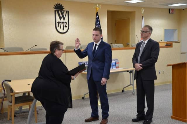 Daniel Hudson is sworn in as a Wallkill Police officer by Town Clerk Louisa Ingrassia.