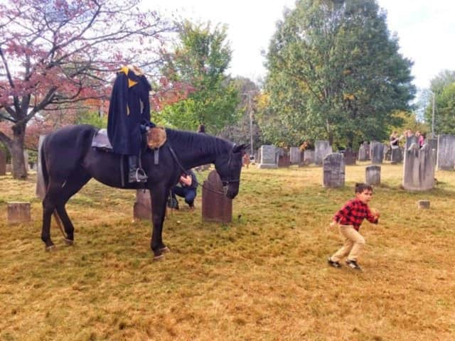 One youngster runs into The Headless Horseman at Sleepy Hollow Cemetery.