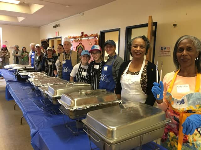 Dozens of volunteers stood at the ready before the start of the Cornerstone Community Church's annual Thanksgiving luncheon.