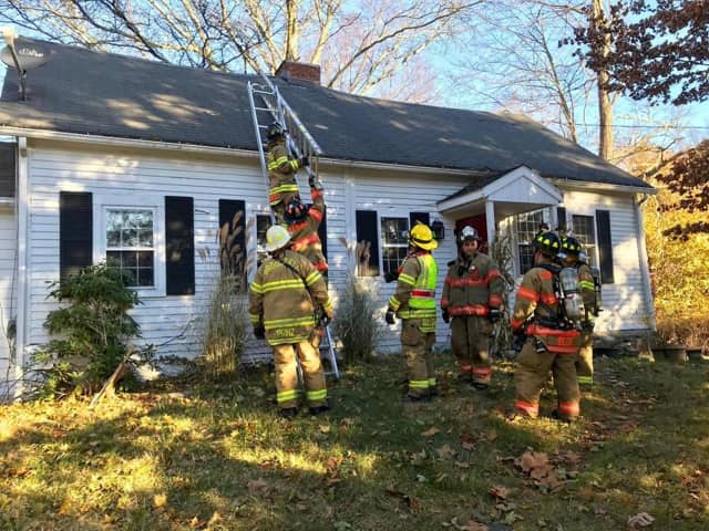 The Brookfield Volunteer Fire Dept. Candlewood Company works at a home with smoky conditions Thursday on Oak Grove Road.
