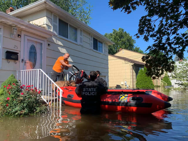 New Jersey State Police rescue residents trapped in houses.