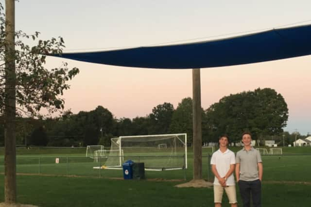 Reed Lyall, who is working on his Eagle Scout project, and his brother, Jack, are working on a pavilion at Kenosia Park.