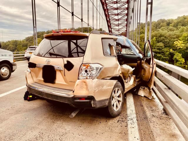 Two people were trapped in an SUV during a three-vehicle crash on the Taconic Parkway.