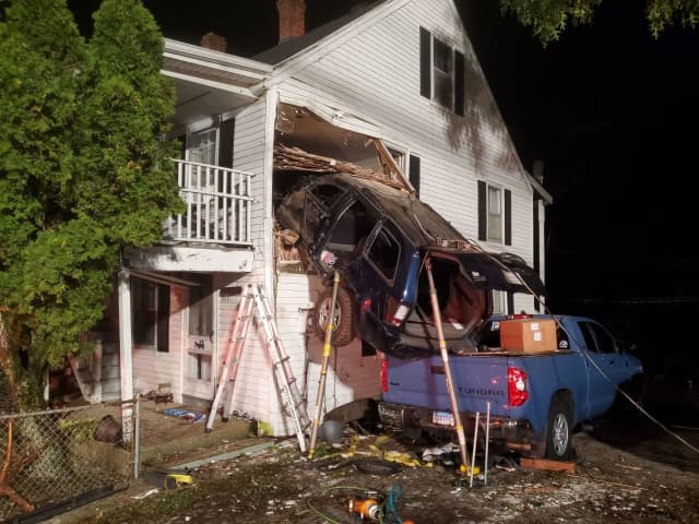 An SUV crash into the second floor of a home.