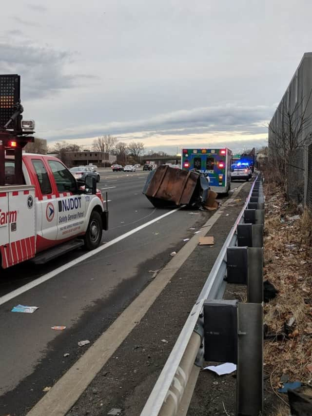 A dumpster that struck a guard rail caused minor injuries in Hackensack.