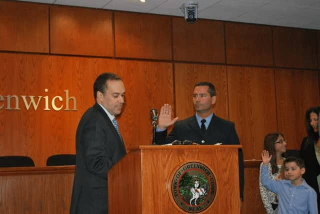 Chris Pratico, who will be sworn in next week as the new fire marshal in Greenwich, is shown being sworn in as deputy fire marshal.