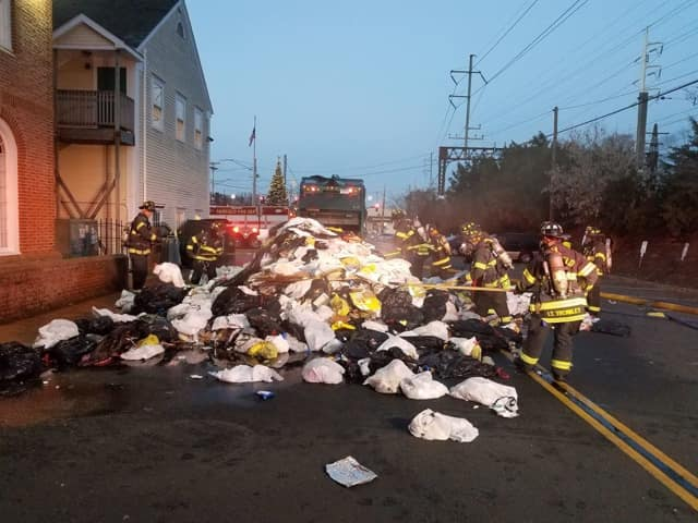 The load of burning trash was dumped onto the road to keep it from spreading the garbage truck, Fairfield firefighters said.