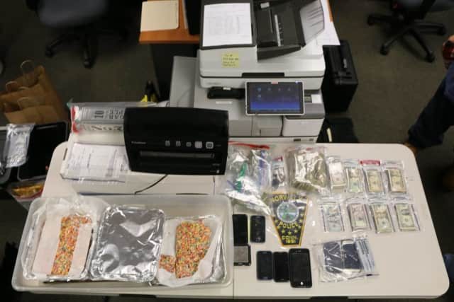 Officers found 200.36 grams of marijuana, four jars of wax marijuana, several trays of homemade edibles believed to be laced with marijuana and $8,137 in cash along with drug paraphernalia in a home in Norwalk, police said.