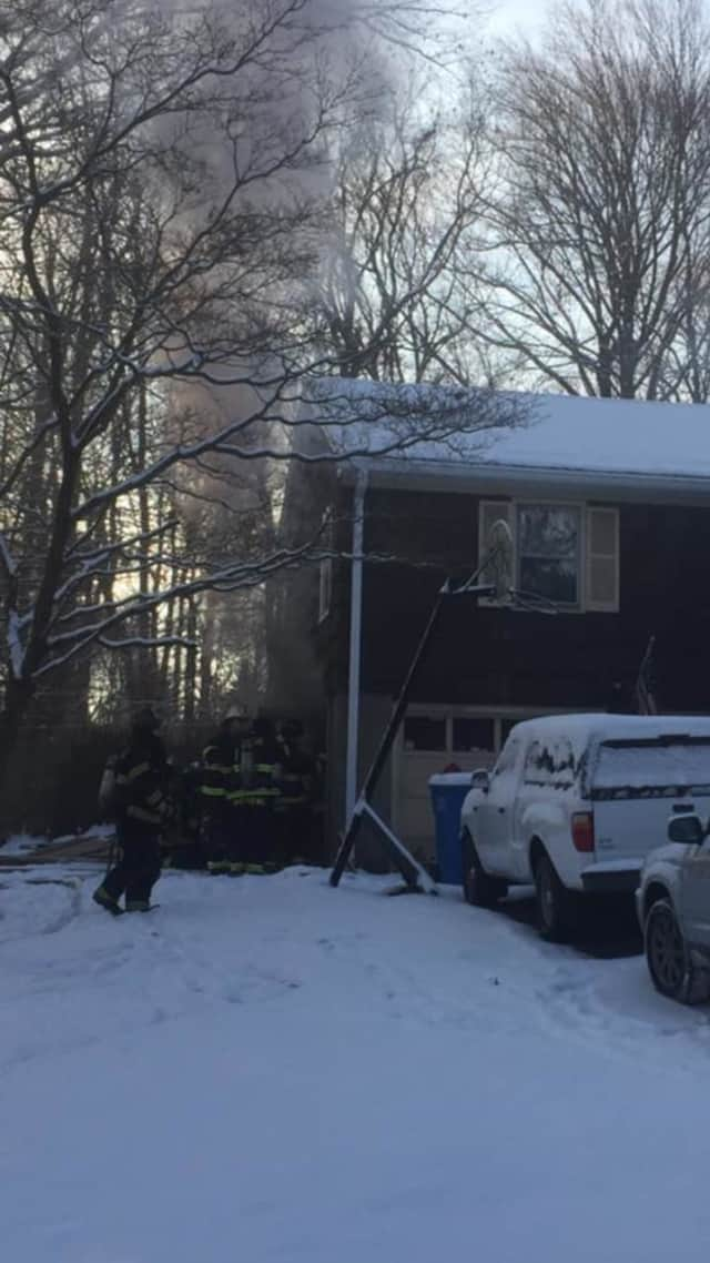 A fire at a home at 70 Osborne Lane in Monroe was contained to the garage on Saturday morning, firefighters said.
