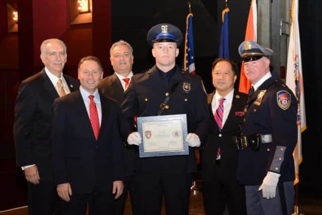 John Hodges (c) graduates from the Westchester County Police Academy. His father, John Hodges (far right) is a Westchester County Police Officer.