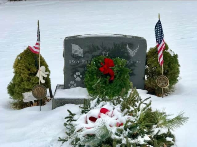 "The grave of U.S. Air Force Staff Sgt. Todd ""TJ"" Lobraico is one of 72 honored at the Sherman North Cemetery In Sherman as part of National Wreaths Across America Day."