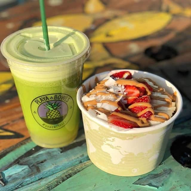 An oatmeal bowl and a juice from Playa Bowls.