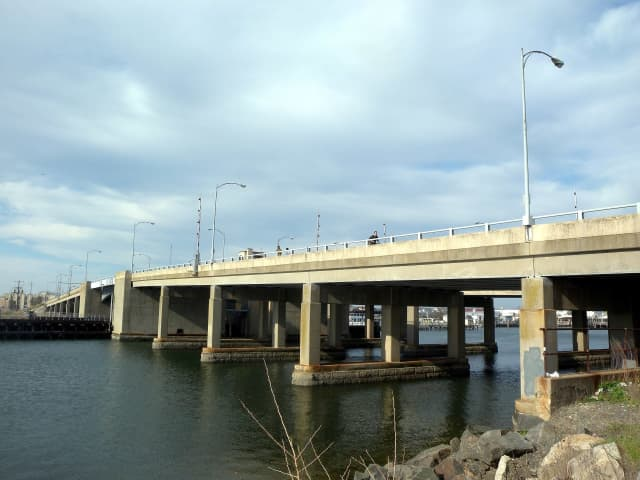 A bridge operator had to be rescued after going through a hole in the deck of the Long Beach Bridge.