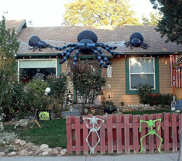 Many people decorate their homes on Halloween.