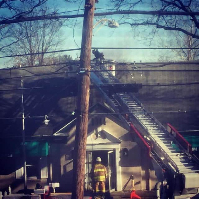 Stratford firefighters overhaul the scene of a laundromat fire Thursday afternoon.