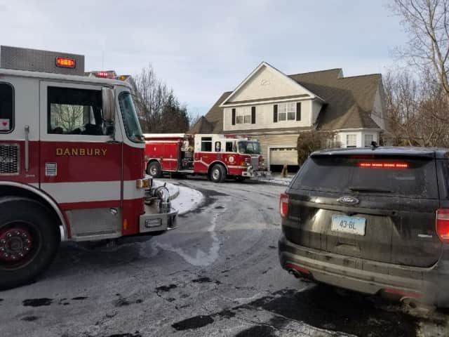 Stony Hill Volunteer Fire Co. and the Danbury Fire Department respond to a water problem at a condo off Shelter Rock Road in Danbury on Tuesday. E26, S1, and E3 are at the scene.