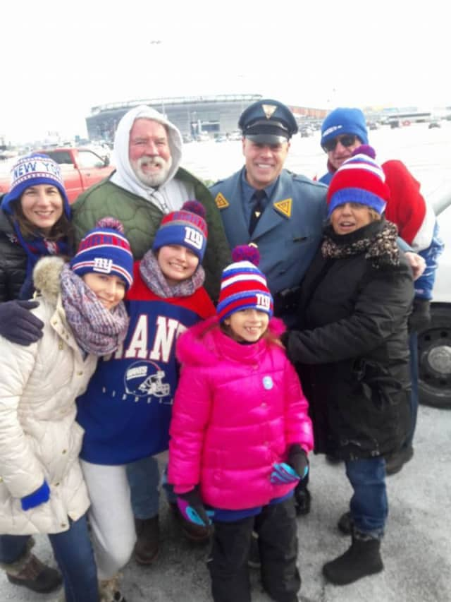 A family waiting to watch the Giants play was thrilled when  New Jersey State Police Detective Dennis Cappello stopped to check on them.