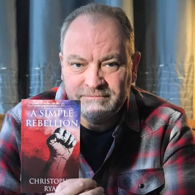 "New Milford's Christopher Ryan and his newest book, ""A Simple Rebellion."""