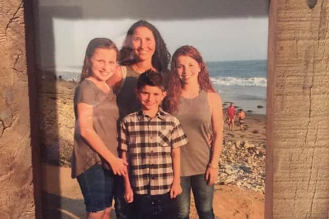 Melanie Fraiman Seigel and her three children of Montvale.