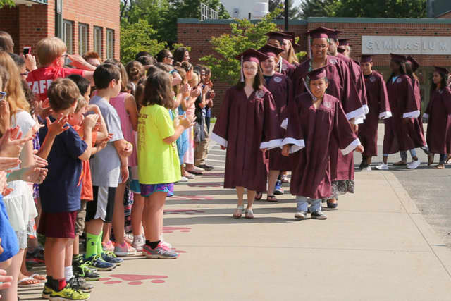 Bethel High School seniors march past younger students during a recent event at Frank A. Berry Elementary School. The Class of 2016 will graduate in a commencement ceremony on Friday.