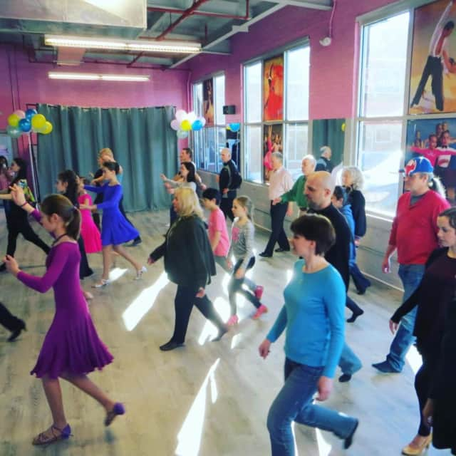 Dancers learn new moves at the  Ballroom Dance Sport Center.