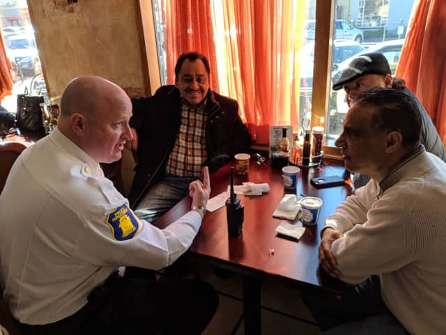 "The Yonkers Police Department has emphasized improving cohesion within the community. Here, officers met with local residents for ""Coffee with a Cop."""