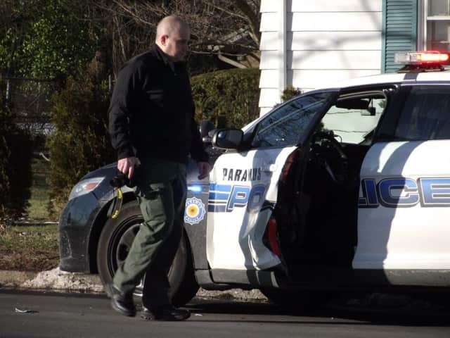 Authorities collect evidence at the scene on Oradell Avenue in Paramus.