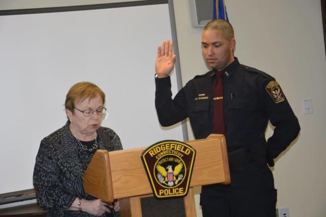 Officer Olivares being sworn in by Town Clerk Barbara Seflilippi