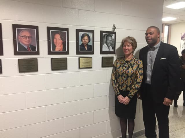 New Wall of Fame inductees Madeline de Vries Hooper and Rasaun Young with photos of themselves and the other two inductees, who could not attend.