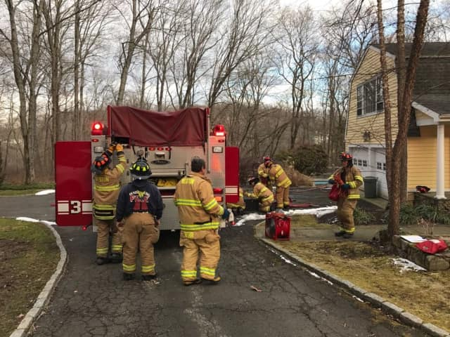 Fire crews are shown at the scene of a house fire in Weston.