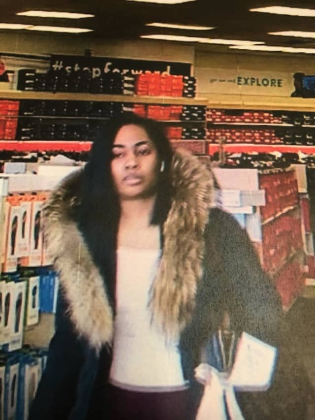 A woman is wanted for allegedly stealing from Famous Footwear in Massapequa.