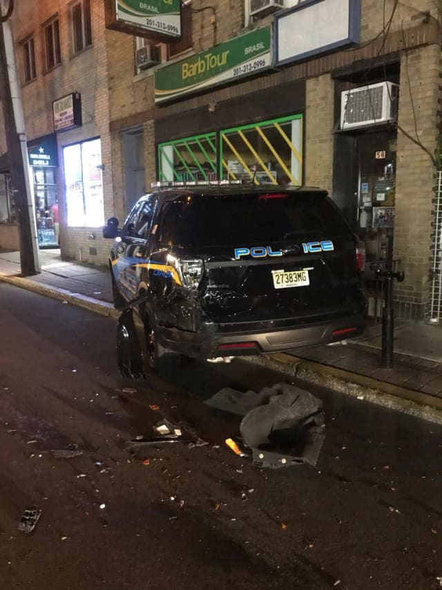 The hit-and-run driver struck the Fairview police SUV with a pickup truck just after midnight, authorities said.
