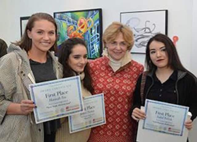 Hannah Fox, Jessica Dantas and Isabel Pollish, with their New Canaan High School teacher Jeanne McDonagh, earned first-place awards for their art work.