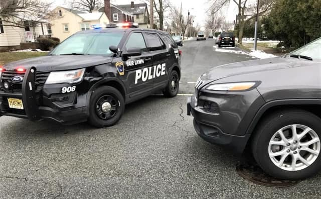 Fair Lawn Police Officer Luis Vazquez emerged with a sore neck after his SUV was rammed by a distracted driver.