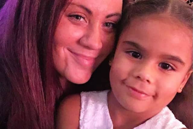 Erin Stack, here with her daughter Emma, was last seen on May 22 in Paterson.