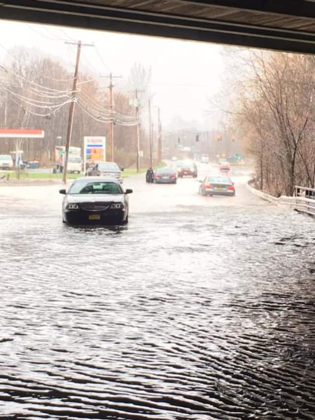 Numerous cars are stuck as several streets have flooded in town.