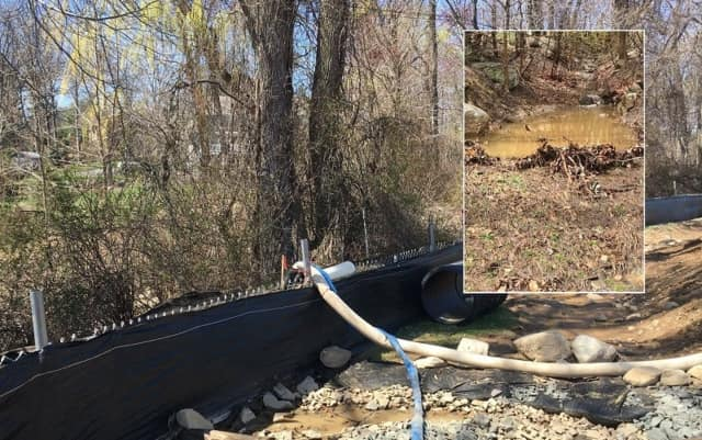 The pumping of muddy water into Pleasant Brook was legitimate, Upper Saddle River officials said Wednesday.