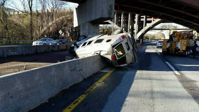 A van drove off the Cross County Parkway overpass and landed in the median of the Bronx River Parkway.