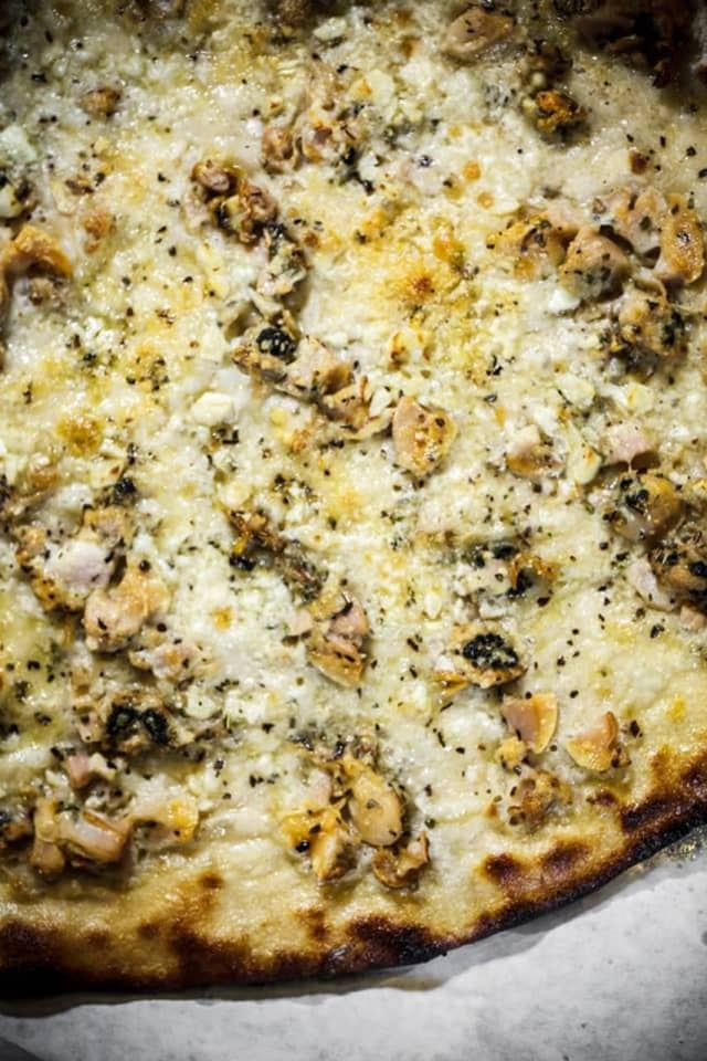 Daily Meal suggests the white clam pie from Frank Pepe's.