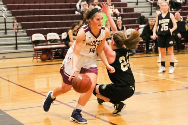 Bethel's Lily Daniels drives on a defender in a game earlier this year. Daniels scored 14 points Monday to lead the Wildcats past Newtown in the SWC girls basketball semifinals.