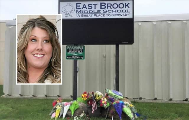 Flowers and candles were left at East Brook Middle School honoring teacher Jennifer Williamson (inset) and a fifth-grader killed Thursday in a school bus crash on Route 80.