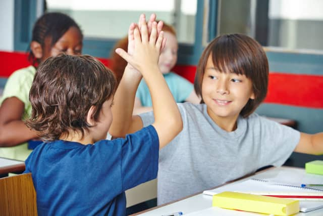 St. Patricks Primary School in Australia banned hugging in favor of high-fives.